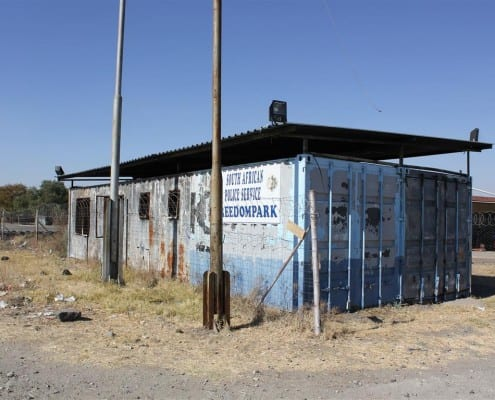 Petrol bombed police station at Freedom Park, with OVC centre directly behind it (South Africa)