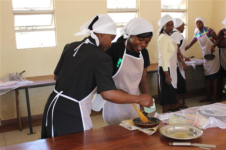 Students Otillia Bunjira and Vimbai Thatope taking part in the catering class at Domboshawa Mobile Skills Training (Zim)