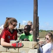 SERVE volunteers building alongside students at Dondo (Moz)