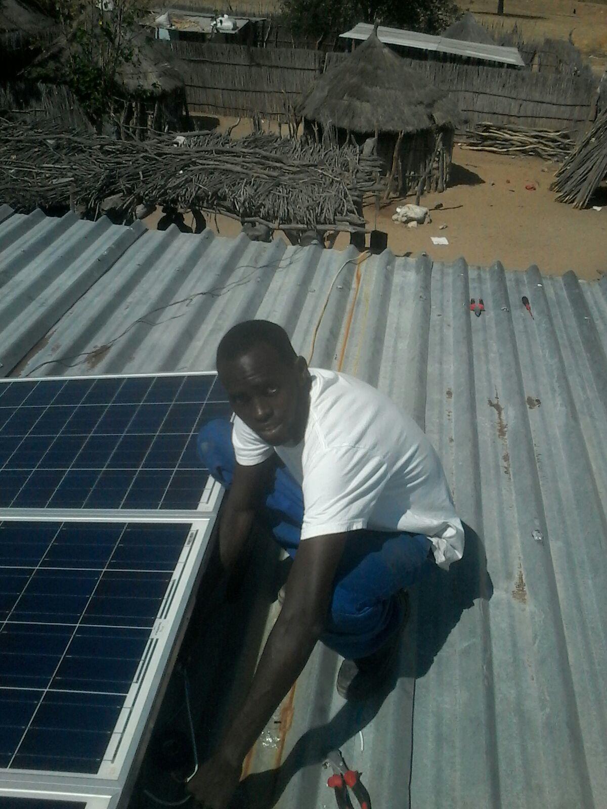 Jonathan installing solar panels