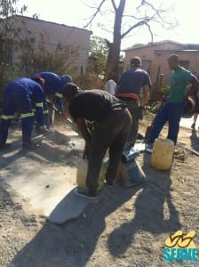 Chris working in partnership with Tsholofelo community in Dichibidu