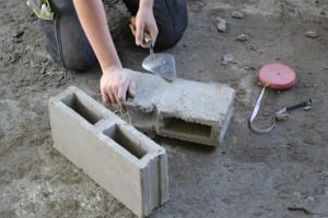 Splitting bricks for use in the construction of the creche kitchen
