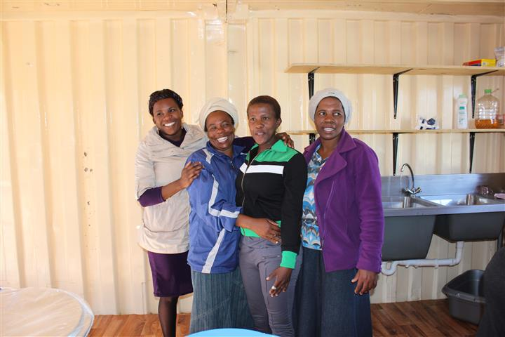 Volunteers in Freedom Park, South Africa in their newly refurbished kitchen which provides food for over 200 Orphaned and Vulnerable Children daily