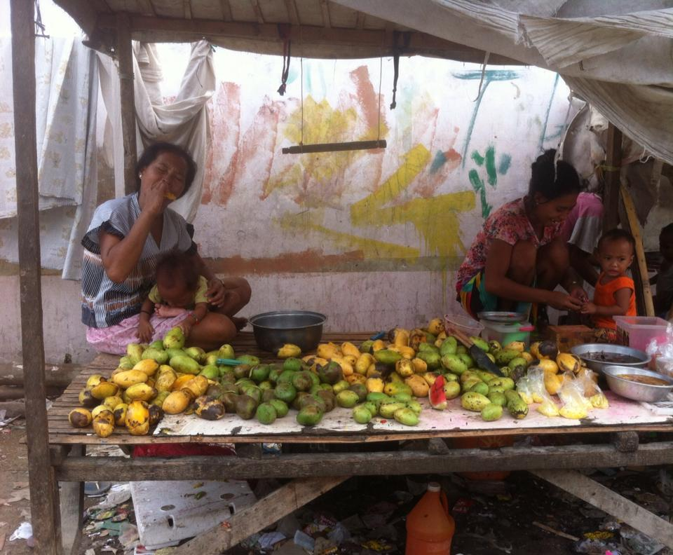 Badjao ladies selling fruit