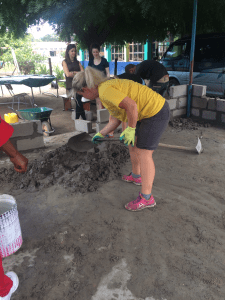 Megan helping with the construction of a new kitchen for the creche at Young Africa Mozambique (Beira)
