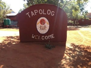 Tapologo (missing the o!) sign at entrance to the Hospice and administrative buildings in Phokeng