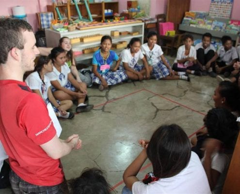 Fiachra facilitating drama workshops with high school Badjao students